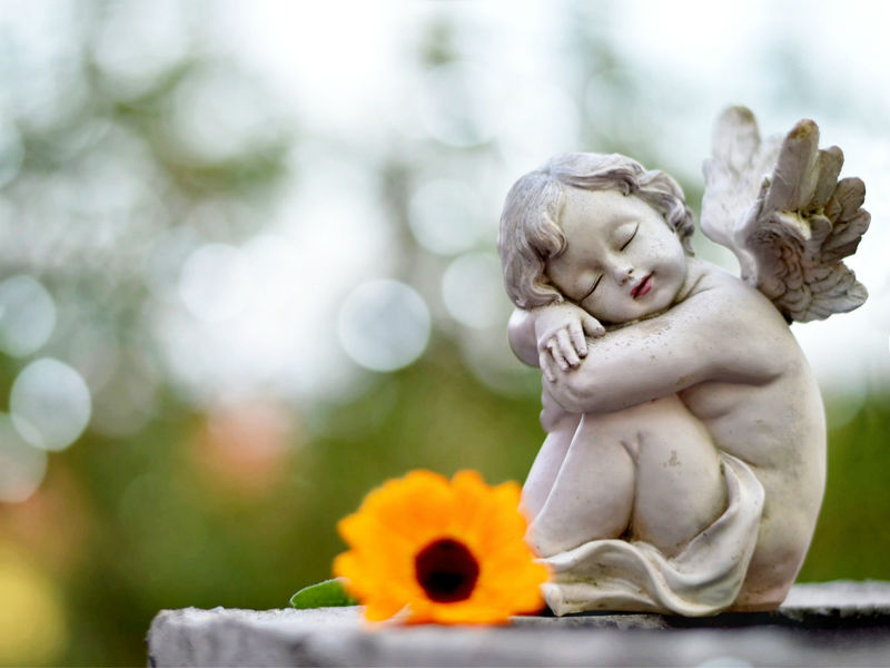 A cherub statue ona child's grave