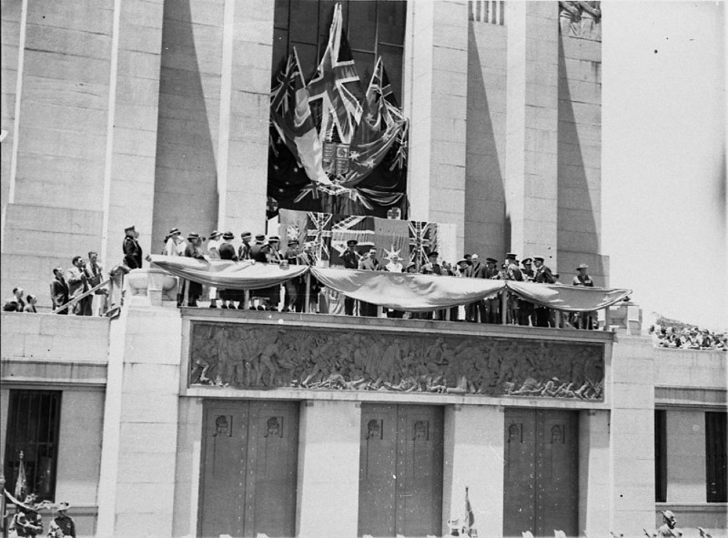 Black and white shot of Prince Henry, Duke of Gloucester opening the Anzac Memorial in 1934; prince Henry and other dignitaries are standing on the balcony of the memorial surrounded by flags