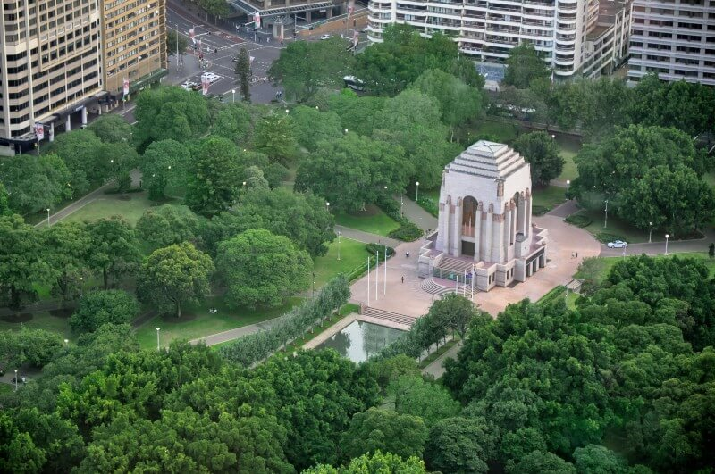 Aerial view of Anzac memorial during the day, surrounded by trees in Hyde Park