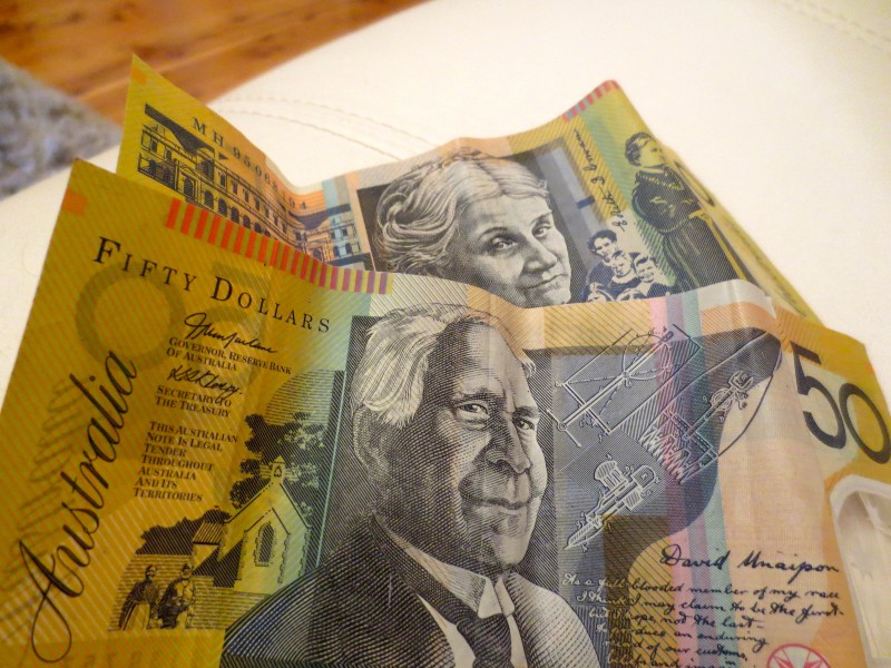Photo of Australian bank notes, including fifty dollar bill, on a table