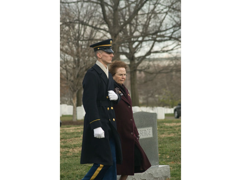 An Arlington Lady is acccompanied as she pays her respects to the fallen at Arlington National Cemetery