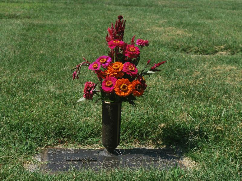 a flower vase on a grave