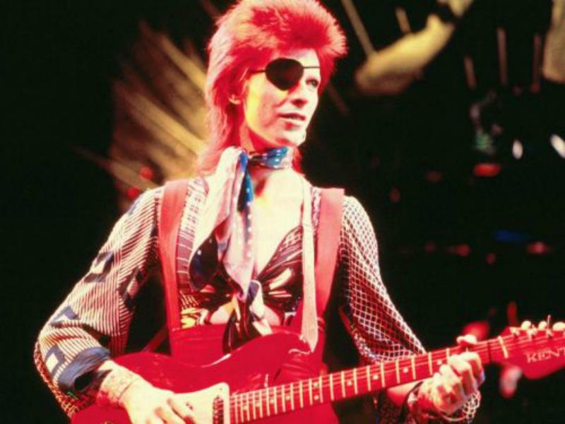 A young David Bowie playing guitar, circa 1974