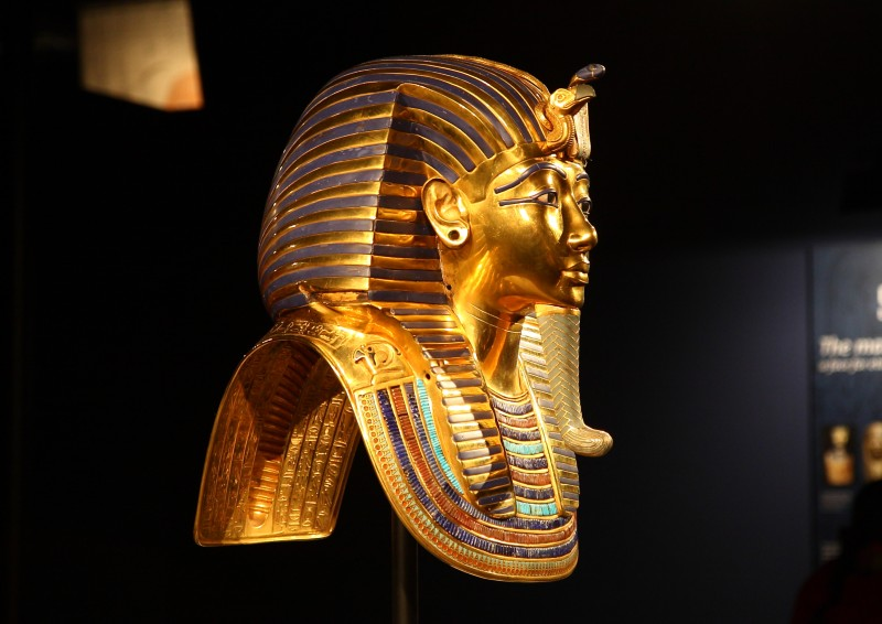 Side view of the golden death mask of Tutankhamun on display in a museum