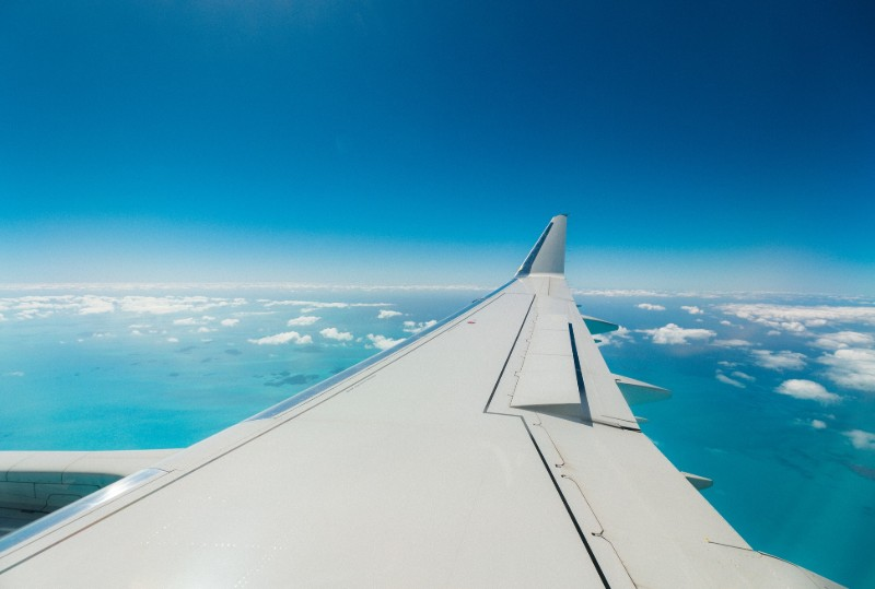view of aeroplane wing from window of plane