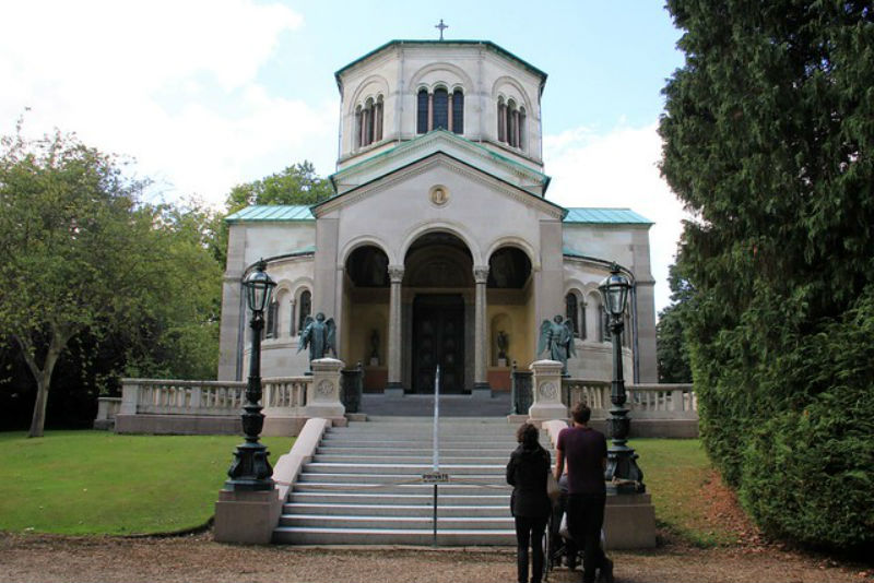 Exterior view of the Royal Mausoleum at Frogmore House with a family climbing the front steps