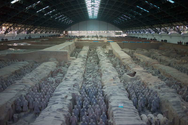 Wide shot of the the mausoleum of the first Qin emperor in China, with columns of terracotta warriors