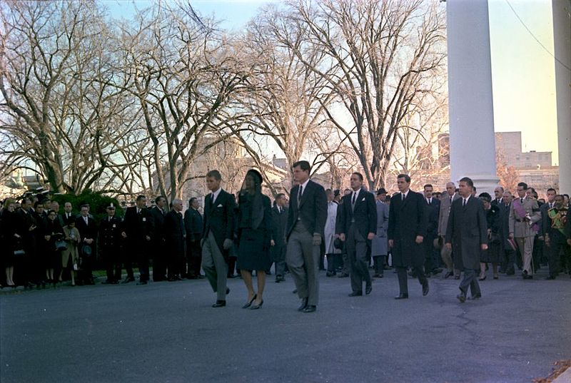 Colour photo of Jackie Kennedy, Robert Kennedy and Edward Kennedy leading the funeral procession of President John F. Kennedy