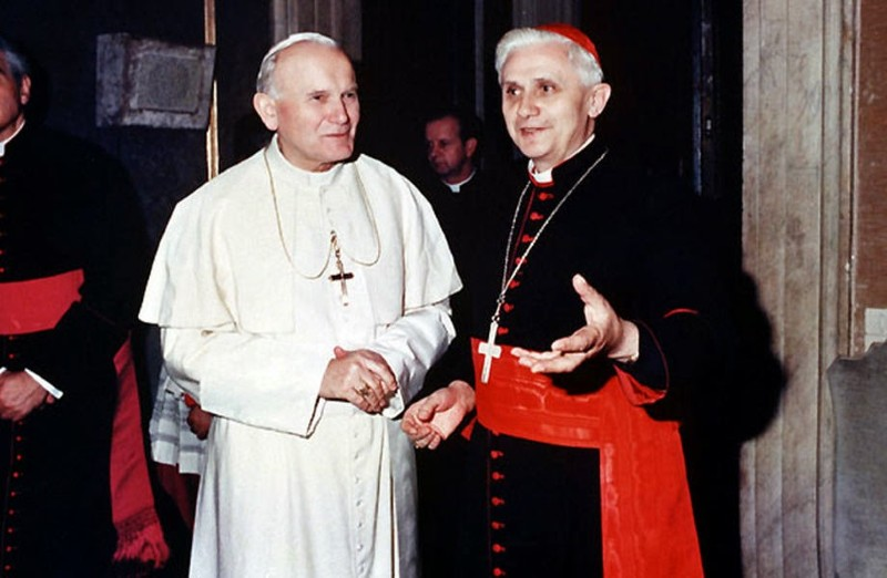 Colour photo of Pope John Paul II in papal clothes with Cardinal Joseph Radzinger in his official outfit