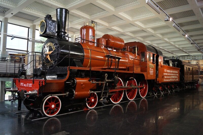 Photo of the red and black steam train that carried Vladimir' Lenin's body to his funeral on display in a museum