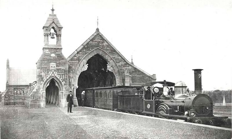 Black and white photograph of Mortuary Station with train at the platform and driver and guards visible