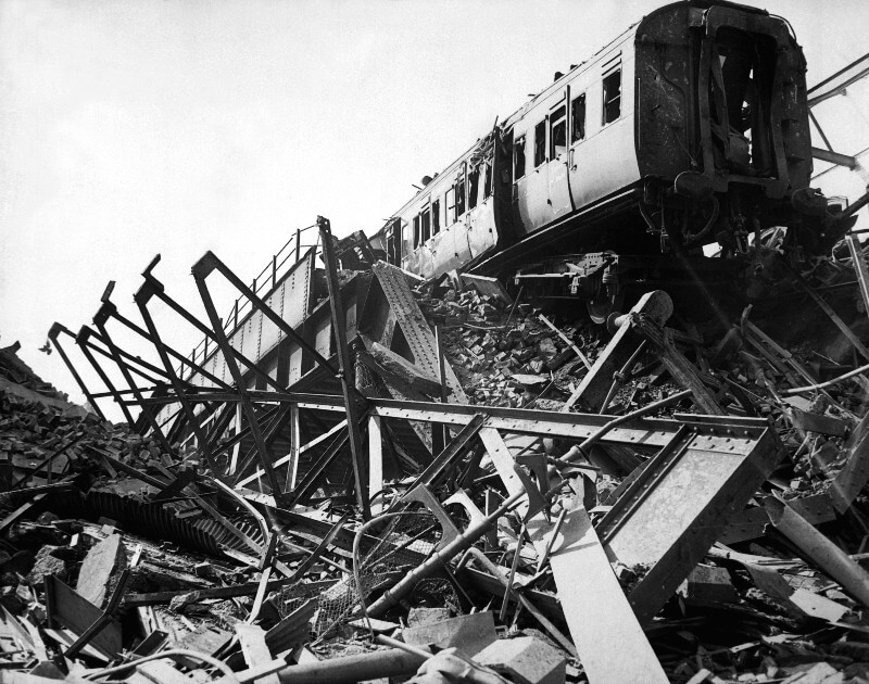 Black and white photograph of ruins of London Necropolis Railway Station with train carriage