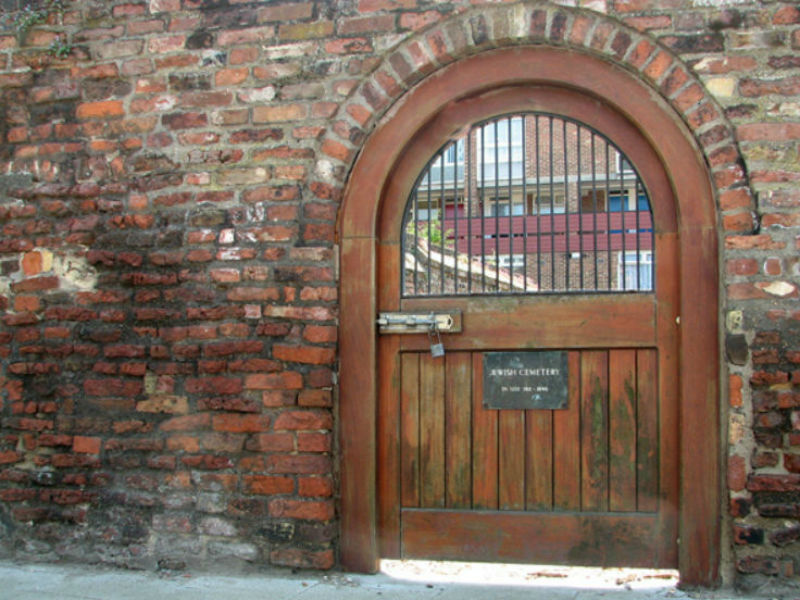 The gated medieval wall enclosing the Jewish Cemetery in King's Lynn