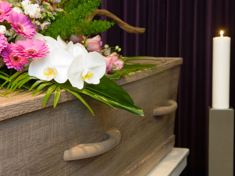 A coffin with a beautiful floral wreath