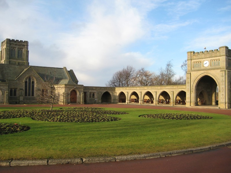 Exterior view of West Road Crematorium, Newcastle, with lawns and flower beds at the front