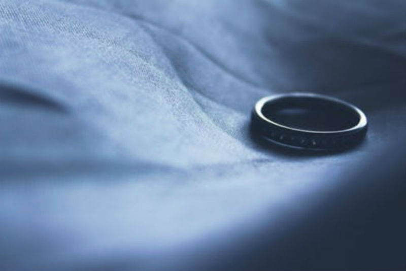 Close-up of a ring lying on a cloth in shadow