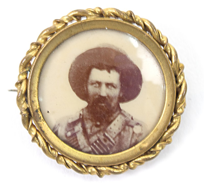 Close-up of mourning brooch, with gold setting containing a picture of a bearded soldier
