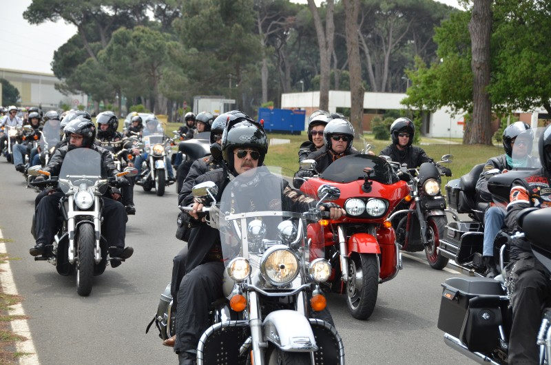 frontal view of motorbike club in convoy
