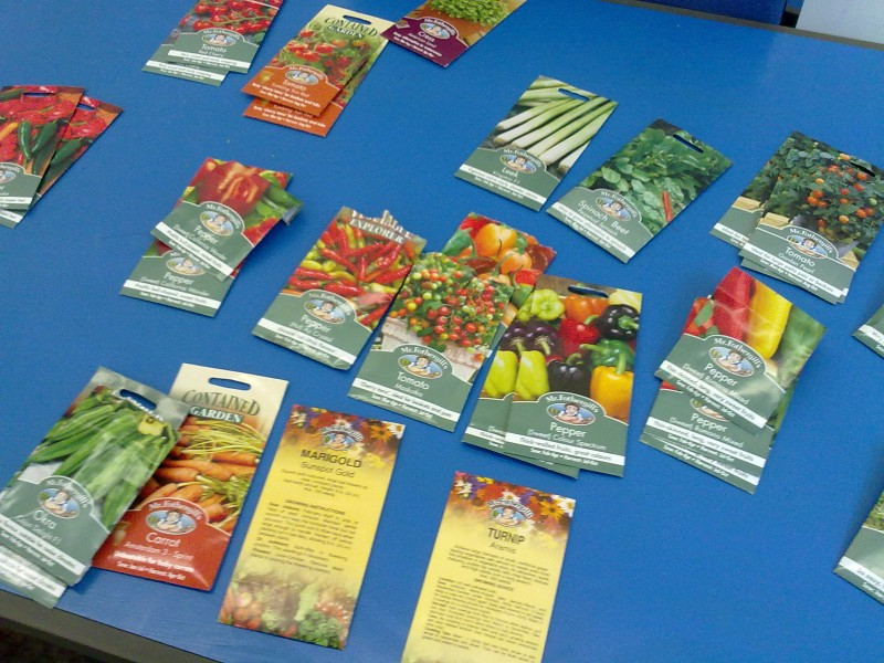 selection of vegetable seed packets on blue table