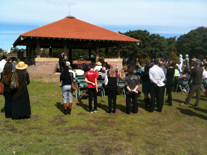photo of mourners attending a funeral outdoors