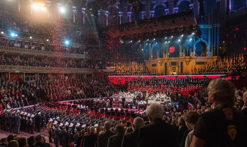 Photo of poppies following on members of the armed forces at the Festival of Remembrance