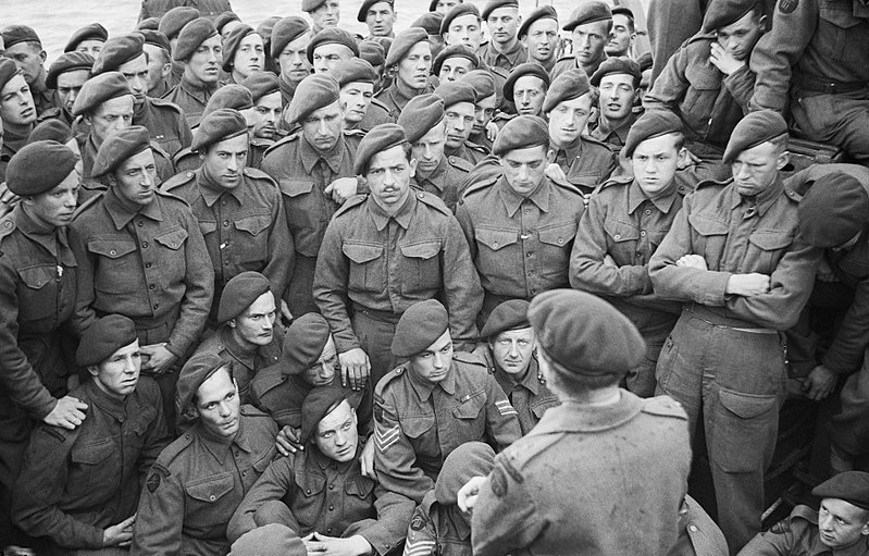 Photo of soldiers on a landing craft recieving a final briefing before the Normandy landings