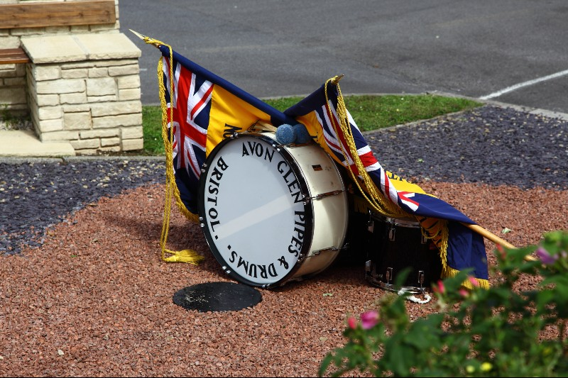 Photo of drumhead alter; military drums draped with regimental colours