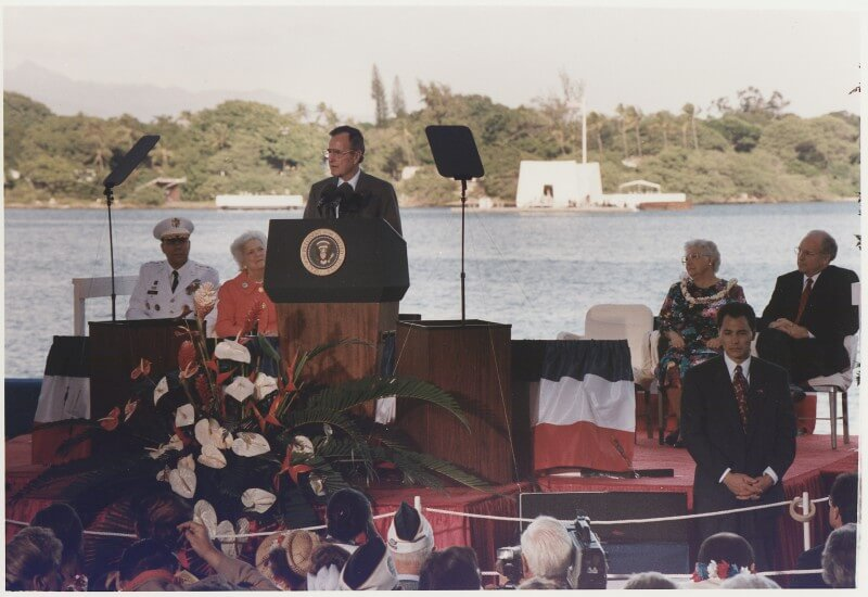 Photo of George H. W. Bush delivering a speech outside