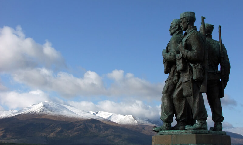 View of commando memorial with snow-topped mountains in the background