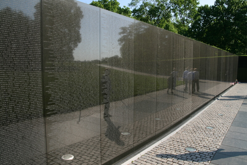 View of Vietnam Veterans Memorial Wall, with people reflected in it