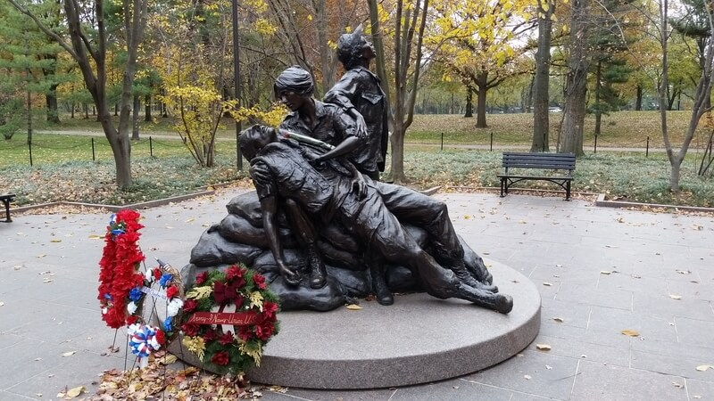 View of Vietnam Womens' Memorial with commemorative wreaths in colours of the American flag laid on the base!