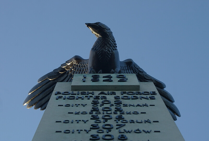 Close-up of eagle on top of Polish War Memorial, with squadron numbers at the top of the pillar below it!