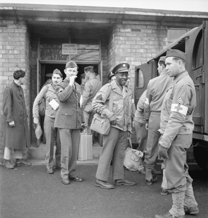 Photo of black and white soldiers leaving a hospital during World War Two
