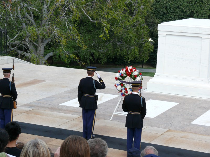 Photo of three us army soldiers laying a wreath at the tomb of the unknown soldier in Arlington National Cemetery