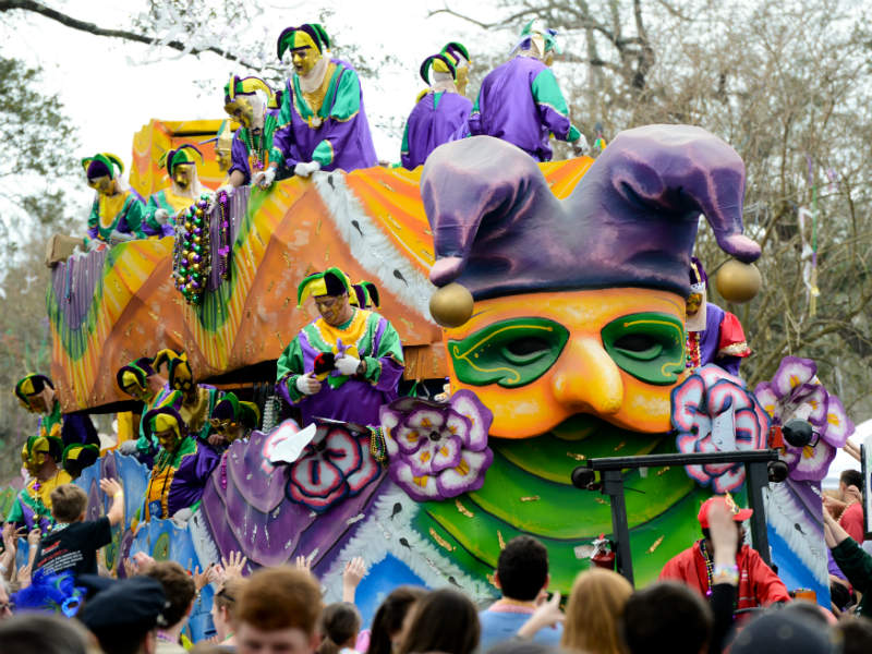 A brightly colored parade float during Mardi Gras