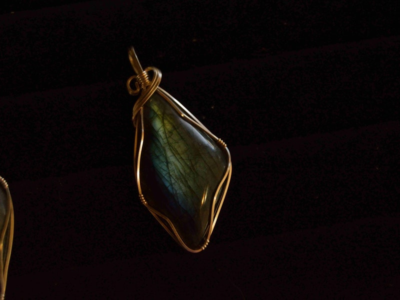 A glass pendant ornamented with gold wire!