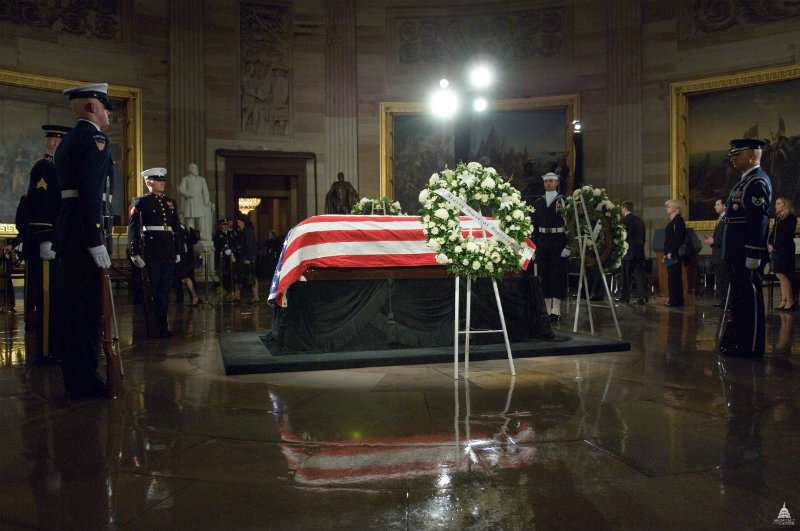 Lincoln's catafalque in use as a statesman lays in state in the capitol rotunda