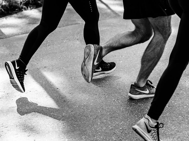 image of runners'legs on a road race