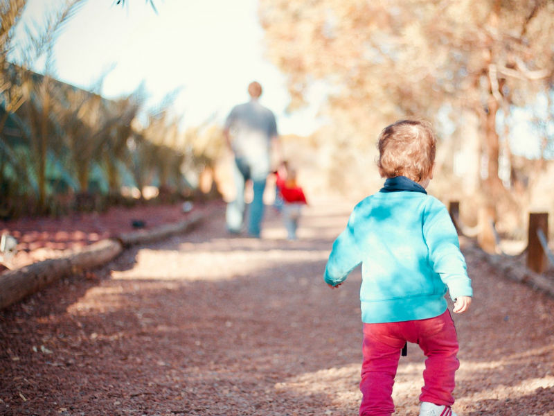 a toddler on a family walk