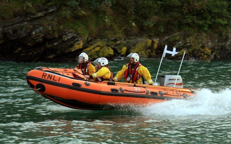 Three RNLI volunteers on a lifeboat