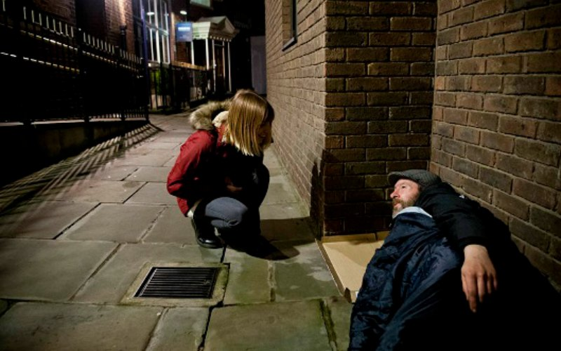 A team member from St Mungo's taling to a homeless man