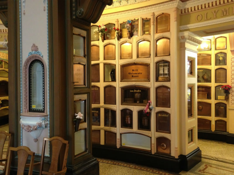 A moodily lit selection of columbarium niches with some open and some closed
