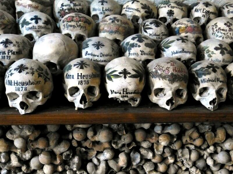 Human skulls painted with names and motifs