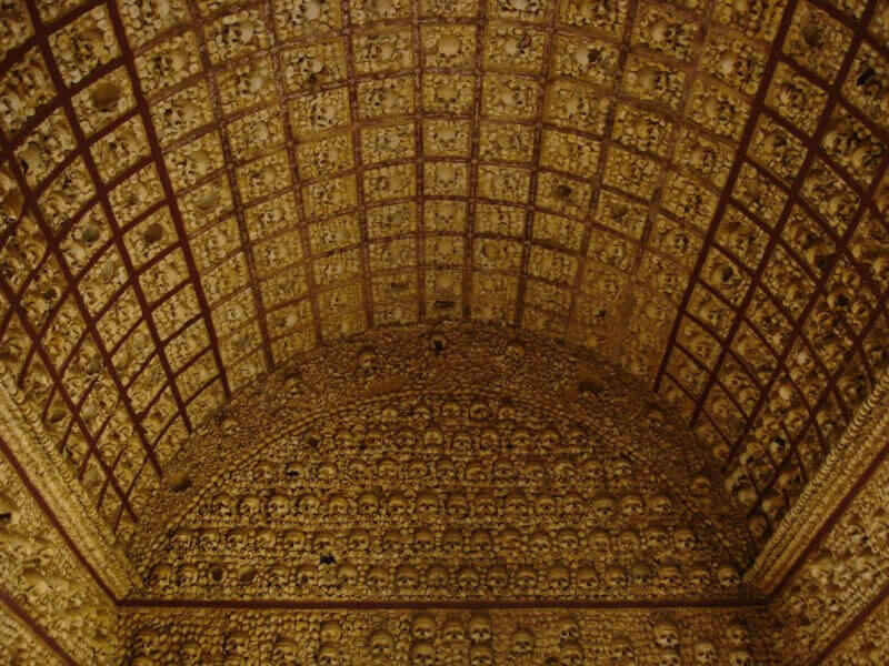 An arched chapel ceiling made from hundreds of human bones and skulls