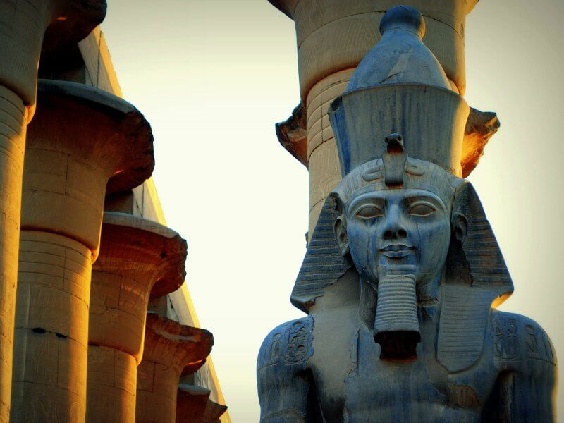 Carved Egyptian statue and temple columns