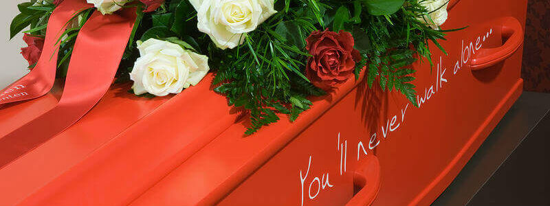 Bright red coffin with custom inscription
