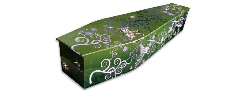 A green coffin with sparkly butterfly design
