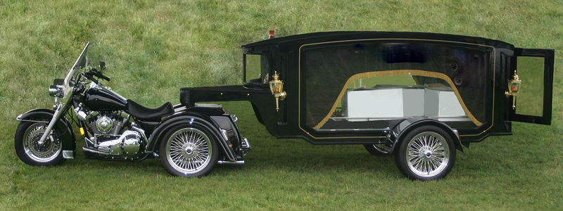 A black motorcycle hearse