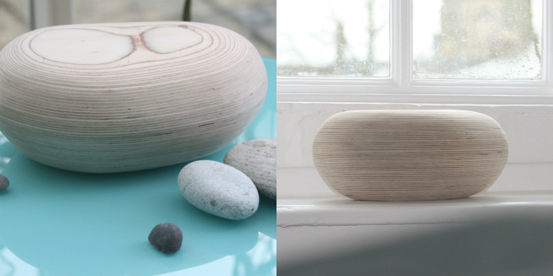 Wooden urn in the shape of a pebble