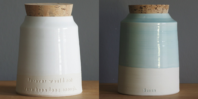 Minimalist ceramic urns with imprinted messages